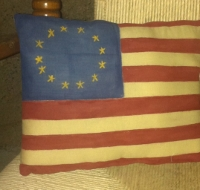 PRIMITIVE FLAG PILLOW